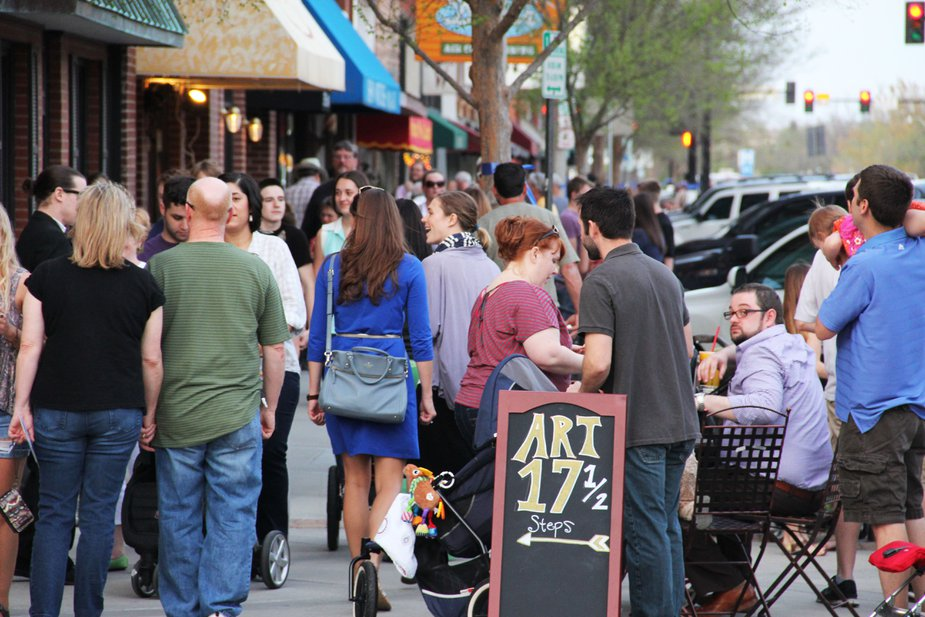 Hustle and bustle in downtown Norman is the default setting during the fun 2nd Friday Norman Art Walk. Photo by Norman Arts Council.