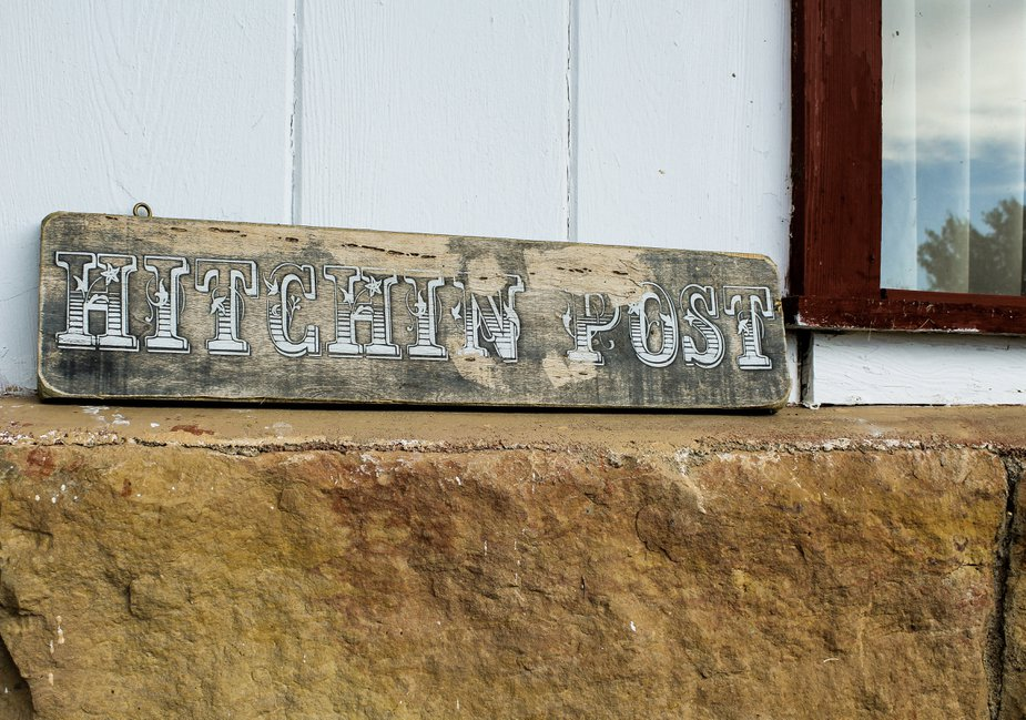 This Hitchin Post sign leans against The Rock House, which was built in about 1910. Photo by Haley Humphrey