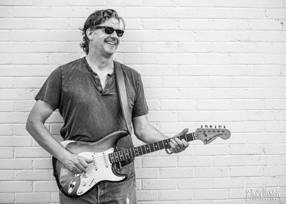 The Brad James Band, headed by Tulsa native James, hits the stage in Perkins with its psychedelic blues fusion. Photo by Phil Clark.