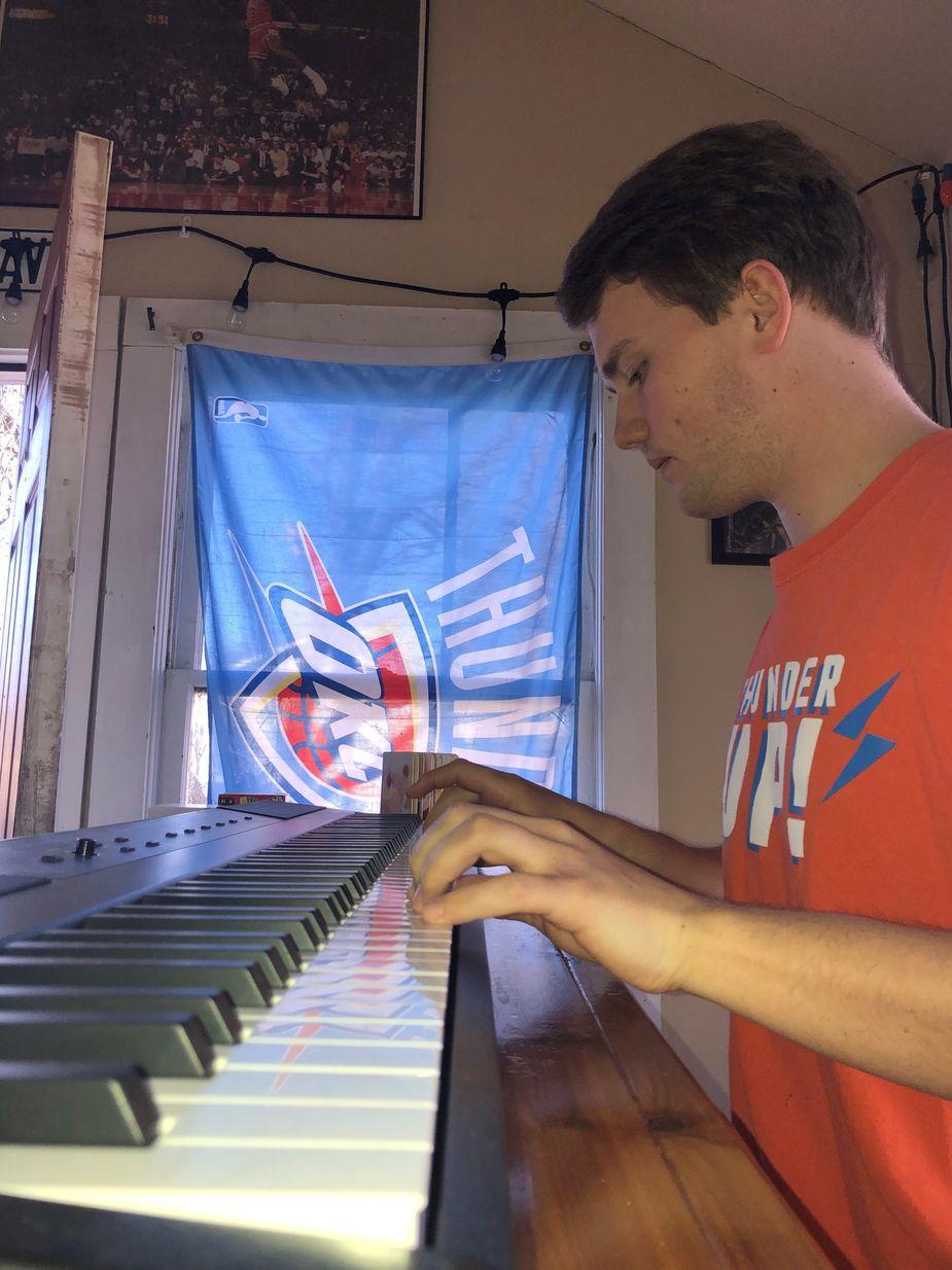 Intern Erik Charlson practices on his keyboard.