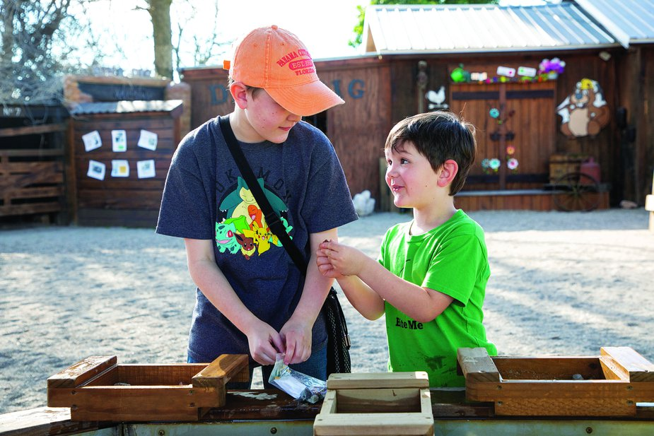Visitors of all ages can mine for gems, rocks, fossils, and more—and learn about geology in the process—at the Beavers Bend Mining Company. Photo by Lori Duckworth