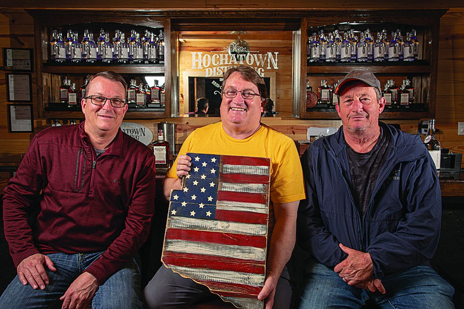 """Mitchell, Tommy """"Blue,"""" and Mark McDaniel of the Hochatown Distilling Company and Mountain Fork Brewery know that a good drink keeps tourists and locals coming back for more. Photo by Lori Duckworth"""