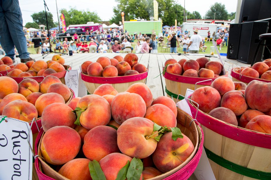 Grab a napkin (or several) for the juicy fare at the Porter Peach Festival. Photo by Lori Duckworth.