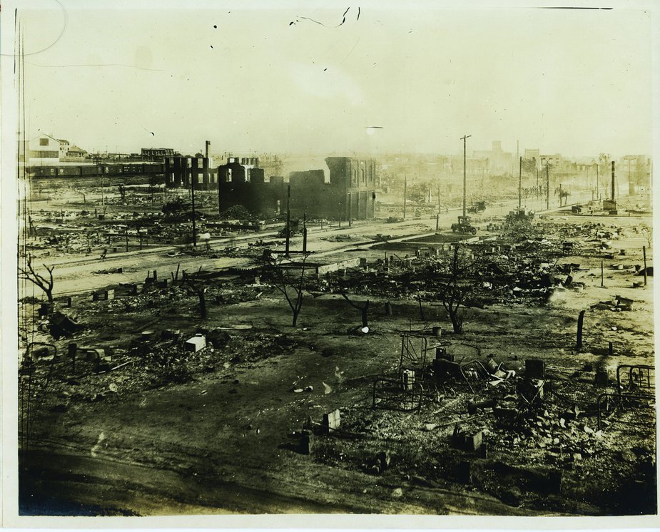 Chimneys, bed frames, and the shells of burned-out buildings were among the few things left standing throughout the neighborhood known as Black Wall Street following the 1921 Tulsa Race Massacre. Photo courtesy of Tulsa Historical Society