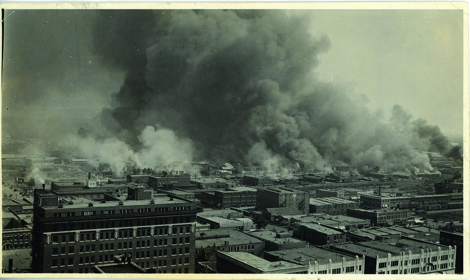 This photograph was taken from the roof of what was then the fourteen-story Cosden Building in downtown Tulsa—now the Mid-Continent Tower—during the Tulsa Race Massacre. Photo courtesy of Tulsa Historical Society