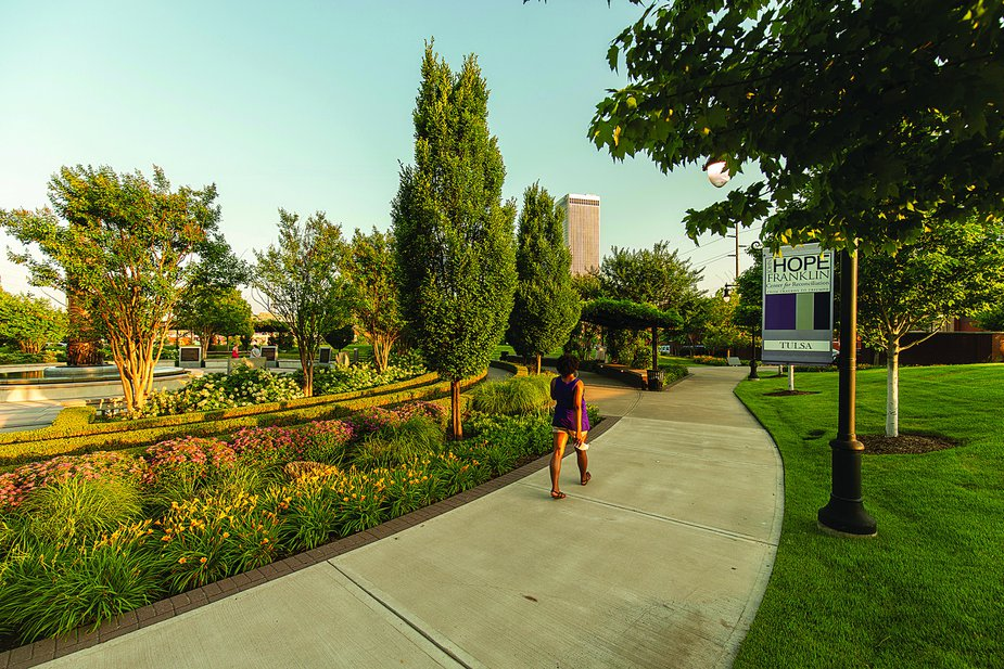 A visitor explores John Hope Franklin Reconciliation Park.  Photo by Shane Bevel